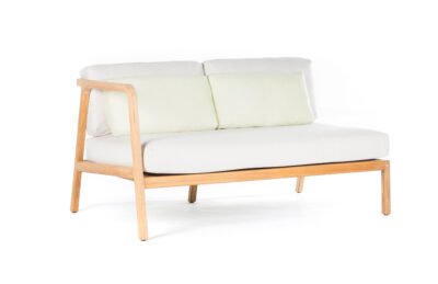 Wooden chair with white pillows and cream cushion