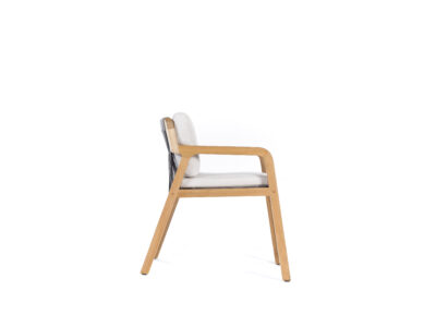 Wooden chair with white cushions on