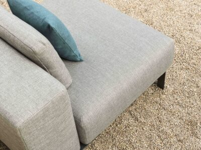 Close up of corner grey outdoor sofa with blue cushion on