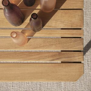 Birdseye view of wooden table with glass bottles on.