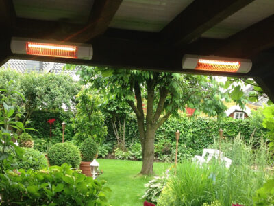 Outdoor heaters attached to the top of a pergola